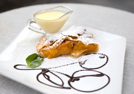 Apricot strudel with custard and mint Stock Photo