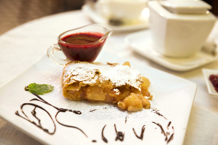 Pear and raisins strudel with berry sauce Stock Photo