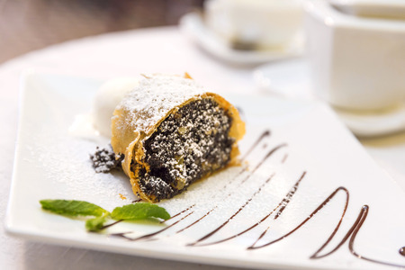 Poppy seeds and walnuts strudel with vanilla ice cream and mint