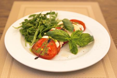 rukola: Caprese Salad - salad with tomato, mozzarella cheese and pesto sauce