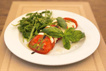 Caprese Salad - salad with tomato, mozzarella cheese and pesto sauce Stock Photo - 38216667