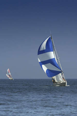 maneuver: Sailing regatta. Sports. The dark blue sky and colour sails. The winner and losed. Stock Photo