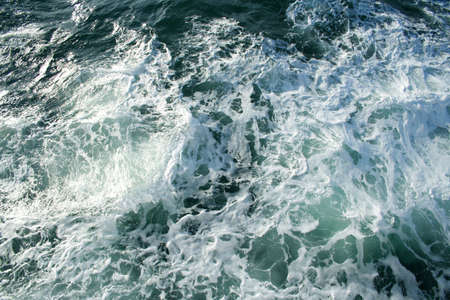 stormy waters: Waves and foam. A sea background. Ideally for your use