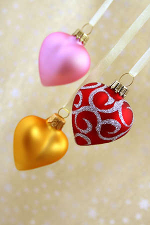 Christmas hearts. Red, pink and golden. Stock Photo - 644932