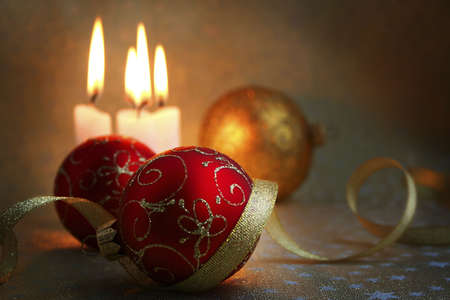 The burning candles, balls and gold ribbons it are Christmas Stock Photo - 644933