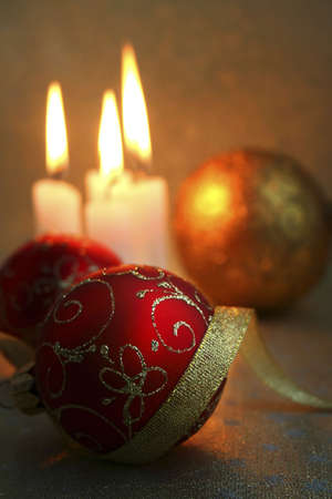 The burning candles, balls and gold ribbons it are Christmas photo