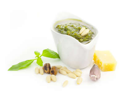 Fresh Pesto and its ingredients isolated on white