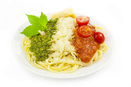 Italian flag - pasta with green pesto, white parmesan and red tomatoes / isolated on white Archivio Fotografico