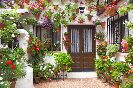 Flowers Decoration of Vintage Courtyard, typical house in Cordoba - Spain, European travel Editorial