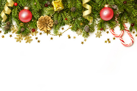 Christmas tree branches with red baubles,  golden stars, snowflakes isolated on white  -  horizontal border Stok Fotoğraf