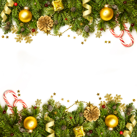 Christmas tree branches with golden baubles, stars, snowflakes -  border isolated on white - horizontal Stock Photo