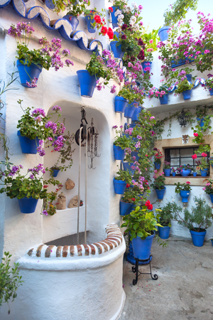 Flowers Decoration of Vintage Courtyard, typical house in Cordoba - Spain, Europe Редакционное