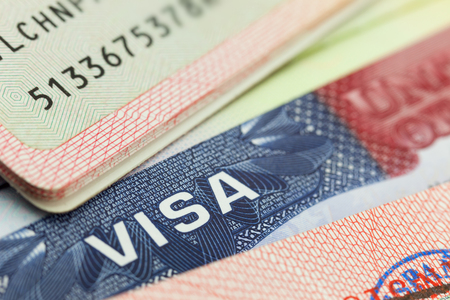 USA visa in a passport - travel background