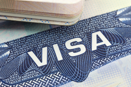The American Visa in a passport page (USA) background 写真素材