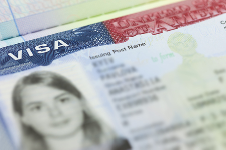 The American Visa in a passport page (USA) background - selective focus Foto de archivo