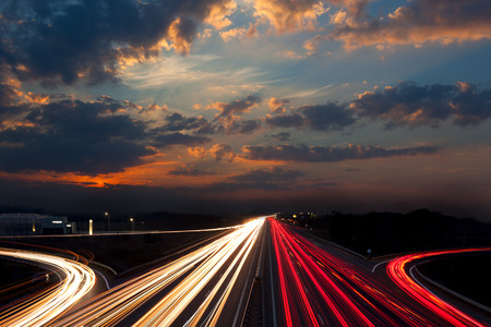 Long Exposure abstract urban background - Speed Traffic  - light trails on motorway highway at night, fantastic sky