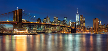 New York - Panoramic view of Manhattan Skyline with skyscrapers  and famous Brooklin Bridge by night, big size Stok Fotoğraf