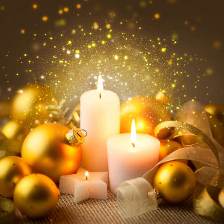 christmas golden candles background with baubles and ribbons magic xmas night with beautiful sparkle lights