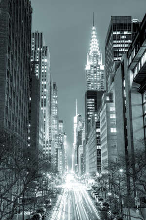 New York City at night - 42nd Street with traffic, long exposure, black and white toned, NYC, USA Фото со стока
