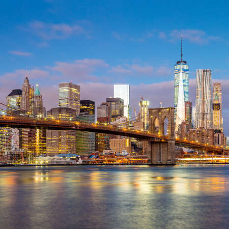 Sunrise view of  Brooklyn Bridge and Lower Manhattan skyline in New York City with city illumination, USA Stock fotó