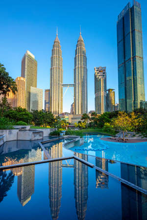 Famous Petronas Twin towers and reflections at early morning, Kuala Lumpur, Malaysia, central park KLCC Editorial