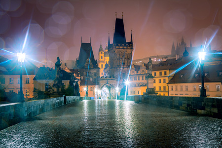 Charles bridge in Prague at night, real rain drops, nobody, Czech Republic, Europe