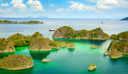 Paradise place - picturesque lagoon with islands and turquoise calm water, Raja Ampat, Papua, Indonesia. Panoramic view, big size Stock Photo