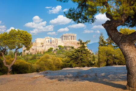 Amazing view of Acropolis hill, Athens, Greece. Famous old Acropolis is a top landmark of Athens. Ancient Greek ruins in the Athens center in summer. Scenic view of remains of antique Athens city