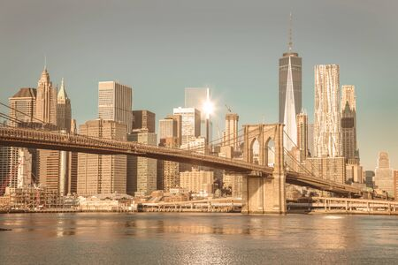 Vintage Famous Skyline of downtown New York, Brooklin Bridge and Manhattan at the early morning sun light , New York City, USA