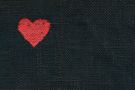 Handpainted heart symbol on a linen material photo