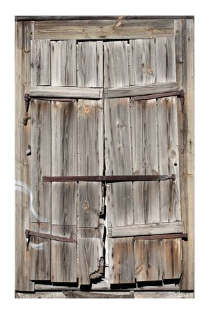 Old window with closed shutters photo