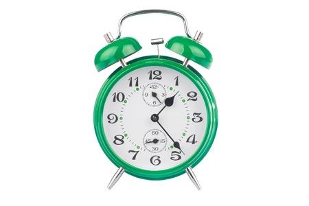 despertador: Verde despertador aislada sobre fondo blanco Foto de archivo