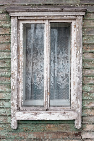 Old window on a aged wooden wall photo