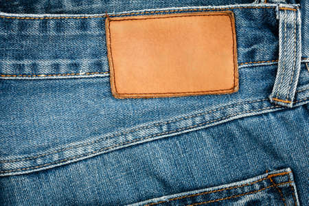 Blank leather jeans label sewed on a blue jeans. Stock Photo - 9356275