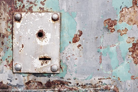 Weathered keyhole on an old rusty metal wall Stock Photo - 9356270