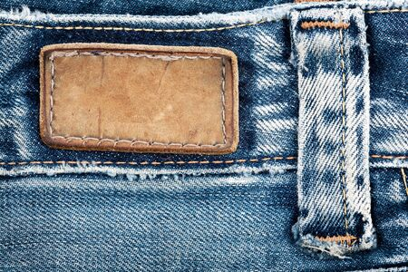 Blank leather jeans label sewed on a blue jeans. Stock Photo - 9436806