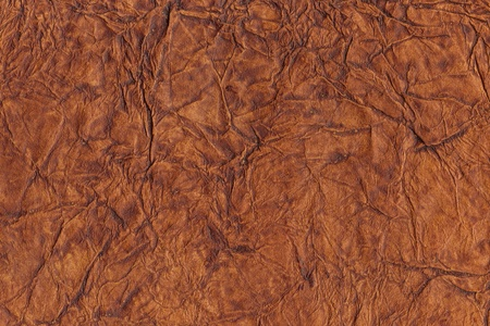 Brown crumpled leather background photo