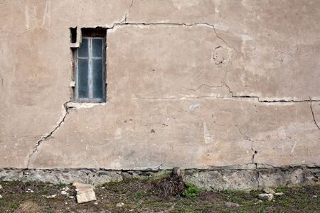Old cracked wall with a window photo