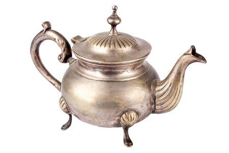 Antique teapot on white background  photo