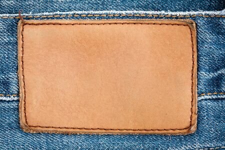 Blank leather jeans label sewed on a blue jeans. Stock Photo - 9861354