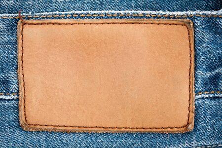 Blank leather jeans label sewed on a blue jeans. Foto de archivo
