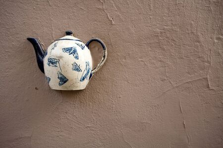 Teapot on a cracked wall Stock Photo - 10403161