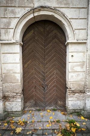 Wooden door in an old wall  photo
