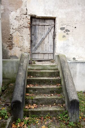 view of a wooden doorway:  Stairs and wooden door in an old wall