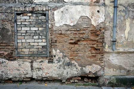 Old gungy wall with immured window Stock Photo