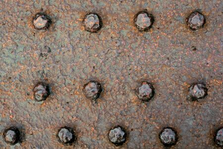 Background of the rivets on rusty metals  photo