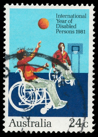 AUSTRALIA - CIRCA 1981: A stamp printed by Australia, shows disabilities to play Wheelchair basketball, circa 1981  photo