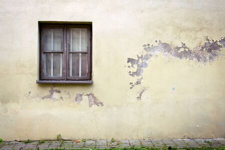 Old cracked wall with a window Stock Photo - 10995017