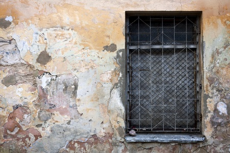 Old cracked wall with a window Stock Photo - 10995023