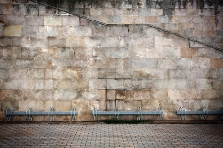 Aged wall with bike stands  Foto de archivo